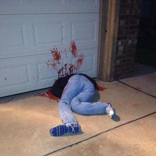Halloween decor outdoor prank - DIY Garage Door Victim