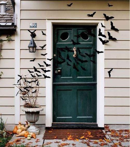 Halloween front door with bats flying across halloween decoration